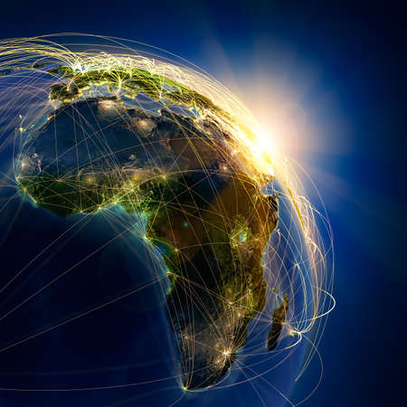 sol naciente: El planeta Tierra altamente detallado en la noche, iluminada por el sol naciente, con los continentes en relieve, iluminados por la luz de las ciudades, translúcidos y de la tierra al mar de reflexión está rodeado por una red luminosa, en representación de las principales rutas aéreas basadas en datos reales Foto de archivo