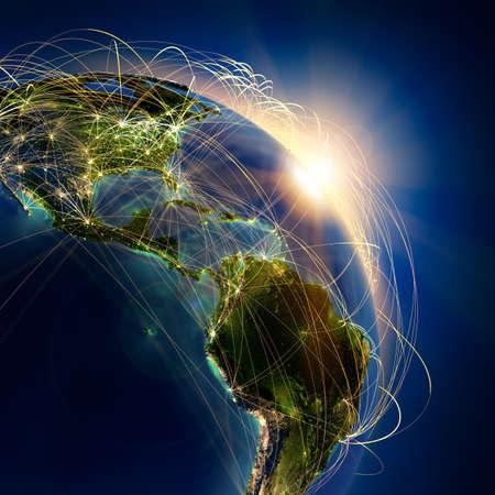 embarque: El planeta Tierra altamente detallado en la noche, iluminada por el sol naciente, con los continentes en relieve, iluminados por la luz de las ciudades, transl�cidos y de la tierra al mar de reflexi�n est� rodeado por una red luminosa, en representaci�n de las principales rutas a�reas basadas en datos reales Foto de archivo