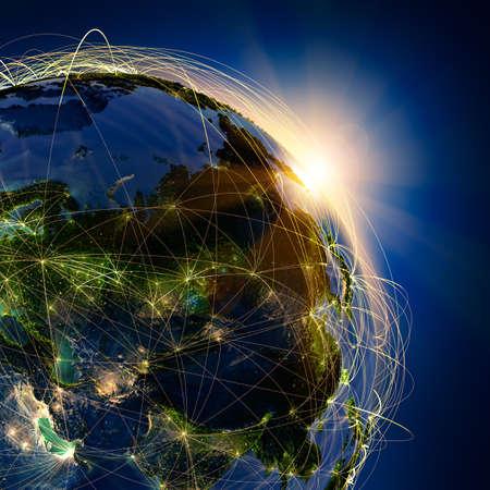 negocios internacionales: El planeta Tierra altamente detallado en la noche, iluminada por el sol naciente, con los continentes en relieve, iluminados por la luz de las ciudades, transl�cidos y de la tierra al mar de reflexi�n est� rodeado por una red luminosa, en representaci�n de las principales rutas a�reas basadas en datos reales Foto de archivo