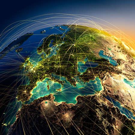 mapa de europa: Muy detallado el planeta Tierra en la noche con los continentes en relieve, iluminados por la luz de las ciudades, transl�cidos y el oc�ano reflexivo. La Tierra est� rodeada por una red luminosa, en representaci�n de las principales rutas a�reas basadas en datos reales Foto de archivo