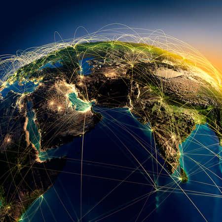 globo terraqueo: Planeta Tierra altamente detallado en la noche con los continentes en relieve, iluminado por la luz de las ciudades, transl�cidos y de la Tierra oc�ano reflexivo est� rodeado por una red luminosa, que representa a los grandes rutas a�reas basadas en datos reales