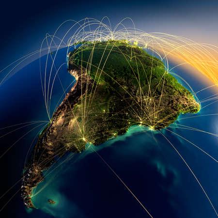 america del sur: Planeta Tierra altamente detallado en la noche con los continentes en relieve, iluminado por la luz de las ciudades, translúcidos y de la Tierra océano reflexivo está rodeado por una red luminosa, que representa a los grandes rutas aéreas basadas en datos reales