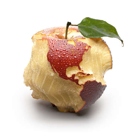 bite: Red ripe apple  Its juicy pulp deeply carved oceans  Apple peel in the form of exact shape of continents is covered with water droplets  Isolated on a white background