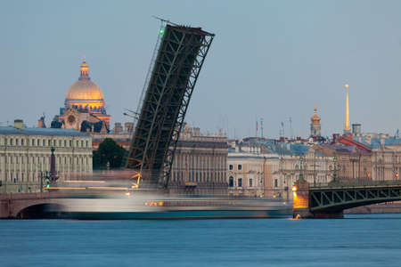 Beautiful view of St  Petersburg White Nights - open Foundry bridge with passing beneath the ship, the Marble Palace and St  Isaac photo