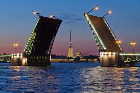 drawbridge: Classic symbol of St  Petersburg White Nights - a romantic view of the open Palace Bridge, which spans between - the spire of Peter and Paul Fortress