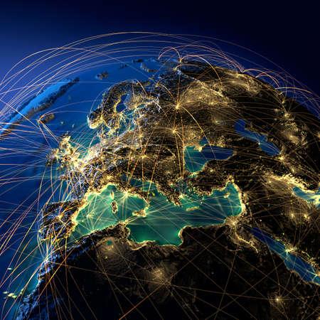 mapa de europa: Altamente detallado planeta Tierra en la noche con los continentes en relieve, iluminados por la luz de las ciudades, translúcidos y el océano reflexivo. La Tierra está rodeada por una red luminosa, en representación de las principales rutas aéreas basadas en datos reales