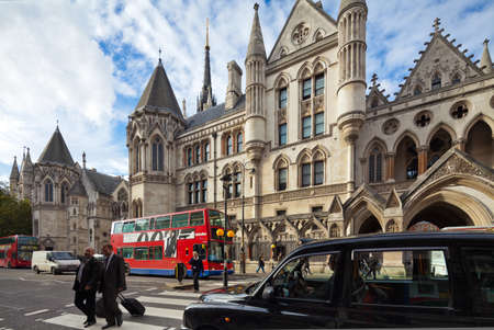 courthouse: The Royal Courts of Justice, Law Courts, is the building in London which houses the Court of Appeal of England and Wales and the High Court of Justice of England and Wales  Photograph taken with the tilt-shift lens, vertical lines of architecture preserve Editorial