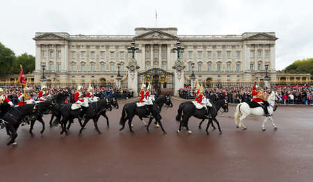 LONDON - OCTOBER 18: Marching the Queen's Guards during traditional Changing of the Guards ceremony at Buckingham Palace on October 18, 2012 in London, United Kingdom.