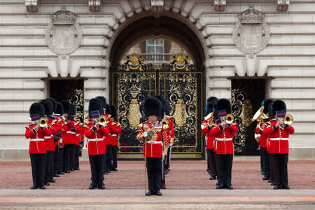BEEFEATERS, LONDON - OCTOBER 18: A Royal Guard at Buckingham Palace parade in London, England. 2012 The Guard provides a full Military Band consisting of no fewer than 35 musicians.