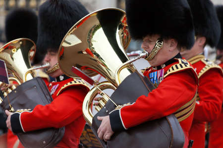 LONDON - OCTOBER 18: Marching the Queens Guards during traditional Changing of the Guards ceremony at Buckingham Palace on October 18, 2012 in London, United Kingdom. Trumpeters of the Royal Guard