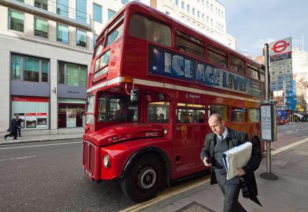 verticals: LONDON - OCTOBER 18  Fleet Street  Routemaster departs from the bus stop  London, UK  2012  Cityscape shot with tilt-shift lens maintaining verticals