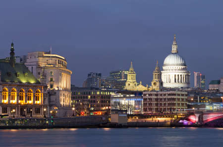 View of the Thames and St Paul's Cathedral at dusk. Lighting of buildings already on, but the sky was still bright. The most beautiful moment. London. UK Stock Photo - 18402889