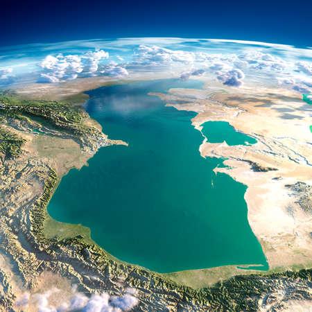 Zeer gedetailleerde fragmenten van de planeet Aarde met overdreven opluchting, doorschijnend oceaan en wolken, verlicht door de ochtendzon Kaspische Zee