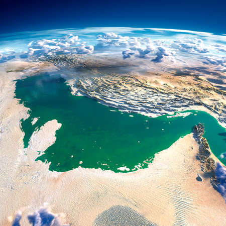 Highly detailed fragments of the planet Earth with exaggerated relief, translucent ocean and clouds, illuminated by the morning sun  Persian Gulf   photo
