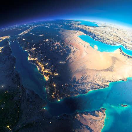非常に詳細な惑星地球。輝く街の明かりの夜日にくずれます。夜 & 日の境界。サウジアラビア。このイメージの NASA によって家具の要素 写真素材
