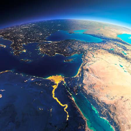 dia y la noche: El planeta Tierra altamente detallado. Noche con las luces brillantes de la ciudad da paso a día. El límite de la noche y el día. África y Oriente Medio. Los elementos de esta imagen proporcionada por la NASA