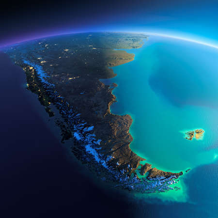 Highly detailed planet Earth. Night with glowing city lights gives way to day. The boundary of the night & day. South America. Tierra del Fuego. Elements of this image furnished by NASA