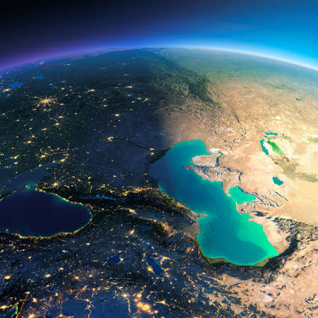 Highly detailed planet Earth. Night with glowing city lights gives way to day. The boundary of the night & day. Caucasus and the Caspian Sea. Elements of this image furnished by NASA