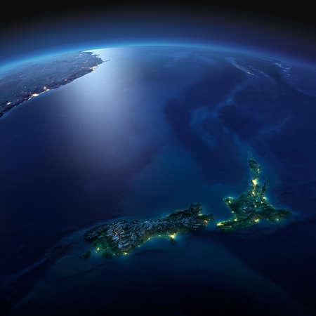正確なと夜地球は、月明かりで照らされた救済と都市のライトを詳しく説明します。ニュージーランド。NASA から提供されたこのイメージの要素