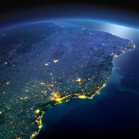正確なと夜地球は、月明かりで照らされた救済と都市のライトを詳しく説明します。南アメリカ。ブラジルの東海岸。NASA から提供されたこのイメー 写真素材