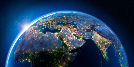 Planet Earth at night with the rising sun with the light of cities illuminating a detailed exaggerated relief. Middle East. 3D rendering.