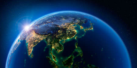 Planet Earth at night with the rising sun with the light of cities illuminating a detailed exaggerated relief. Asian countries. 3D rendering.