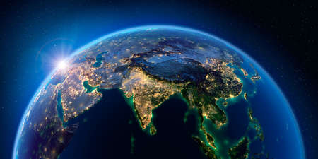 Planet Earth at night with the rising sun with the light of cities illuminating a detailed exaggerated relief. India. South-east Asia. 3D rendering. Stock fotó