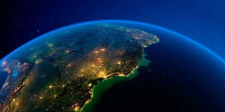 Planet Earth with detailed exaggerated relief at night lit by the lights of cities. Central America. East Coast of Brazil. 3D rendering.
