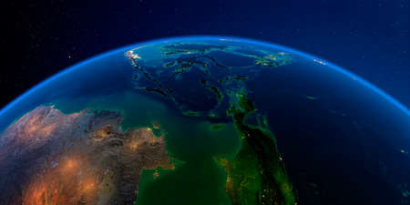 Planet Earth with detailed exaggerated relief at night lit by the lights of cities. Southeast Asia. Indonesia.