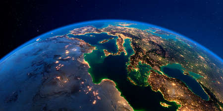 Planet Earth with detailed exaggerated relief at night lit by the lights of cities. Africa and Europe. The waters of the Mediterranean Sea.