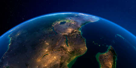 Planet Earth with detailed exaggerated relief at night lit by the lights of cities. East Africa. Mozambique, Tanzania, Kenya.