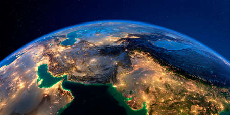 Planet Earth with detailed exaggerated relief at night lit by the lights of cities. South Asia. Pakistan, Afghanistan, India.