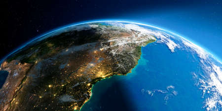 Highly detailed Earth with atmosphere, exaggerated relief and light-flooded cities. Transition from night to day. South America. East Coast of Brazil. 3D rendering.