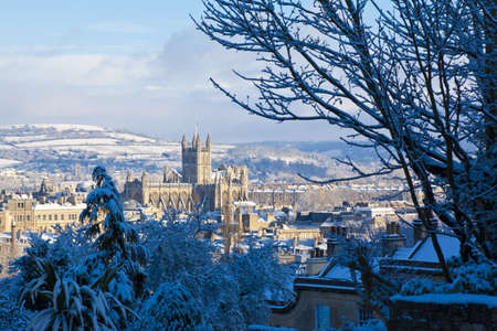 Winter scenic showing Bath Abbey surrounded by Georgian architecture and countryside in Bath, England, UK