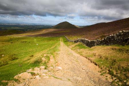 Farm track on beautiful Cumbrian hillside, England, UK. Stock Photo - 17938466