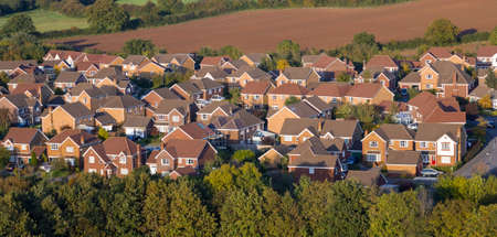 suburban: Modern, red brick houses viewed from above.