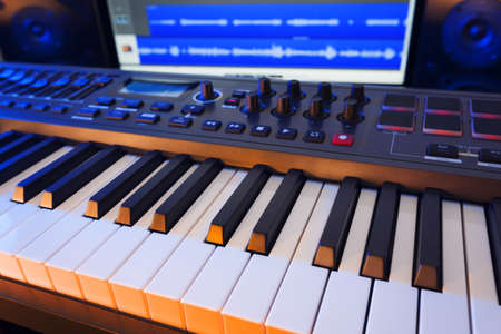 midi: MIDI Keyboard in a computer music studio.