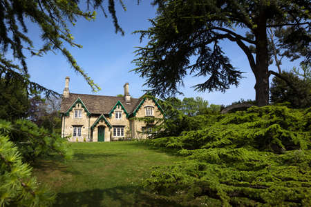 gables: Rustic stone cottage with ornate wooden bargeboards on the gables and surrounded by mature trees