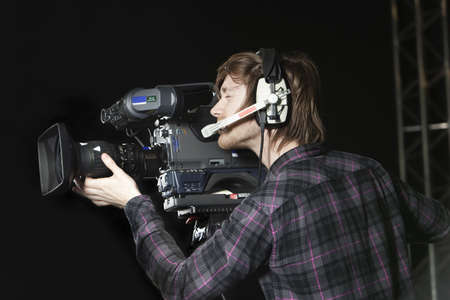 Young man operating a Television Camera in a TV Studio  Stock Photo