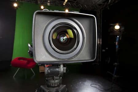 tv camera: Close-up of a Television Camera lens in a studio environment