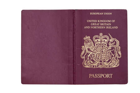 travelled: Cover of an open UK Passport, isolated against white with clipping path  Stock Photo