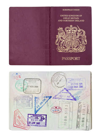 Inside and outside of a well travelled UK Passport, isolated against white with clipping path