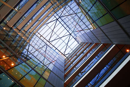 Bright and colourful atrium of a modern glass building