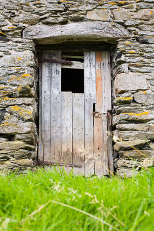 Rustic wooden door on stone barn in Cumbria, England, UK Stock Photo - 17985373