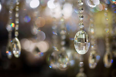 Close-up of a cut glass chandelier and the resultant abstract light reflections and refractions  Stock Photo - 17980684