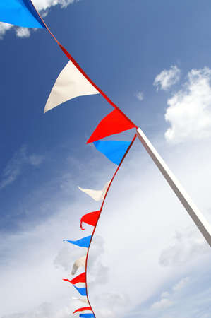 fete: red, white and blue bunting at a summer fete in England, UK