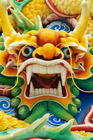 blue dragon: Close-up of a Carved Serpents head at a Chinese Temple in Kuala Lumpur, Malaysia  Stock Photo