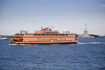 A Staten Island Ferry sails across Upper New York Bay on 17th September 2008  The ferry provides clear views of the Statue of Liberty which can be seen in the background  Editorial