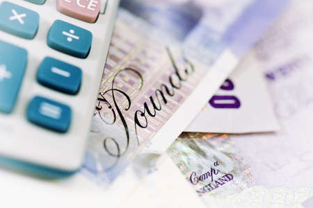 Close-up of a Calculator and British Bank notes  Selective focus and soft white vignette Stock Photo - 17980694