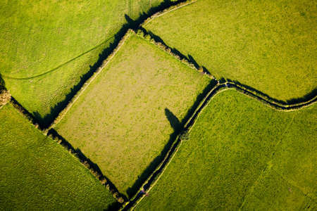 Aerial view showing geometric lines and shapes made by field boundaries in British countryside  Stock Photo